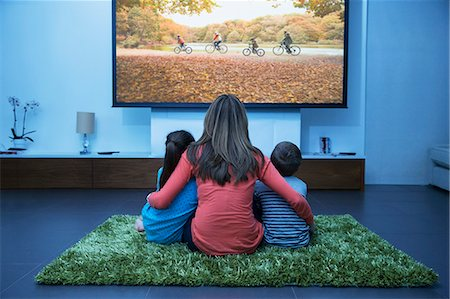 Mother and children watching television in living room Stock Photo - Premium Royalty-Free, Code: 6113-07730562
