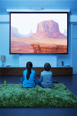 Children watching television in living room Stock Photo - Premium Royalty-Free, Code: 6113-07730566