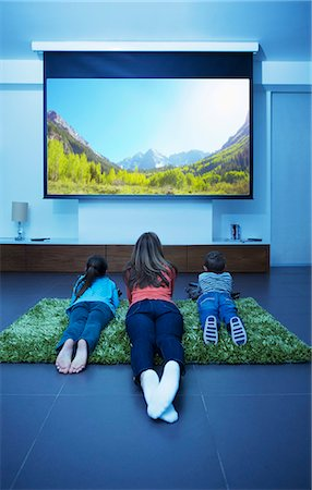 Mother and children watching television in living room Stock Photo - Premium Royalty-Free, Code: 6113-07730568