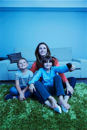 Mother and children watching television in living room Stock Photo - Premium Royalty-Free, Code: 6113-07730569