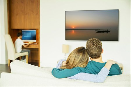 Couple watching television in living room Stock Photo - Premium Royalty-Free, Code: 6113-07730507