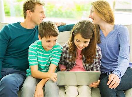 Family relaxing together on sofa Stock Photo - Premium Royalty-Free, Code: 6113-07730522