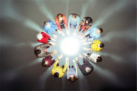 strategy - Crowd forming circle around bright light Stock Photo - Premium Royalty-Free, Code: 6113-07730645