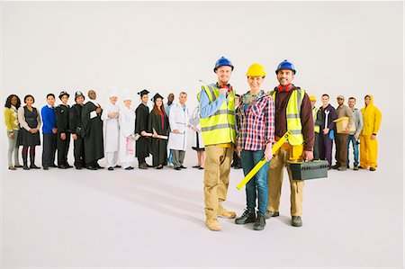 female police officer happy - Portrait of construction workers in front of workforce Stock Photo - Premium Royalty-Free, Code: 6113-07730650
