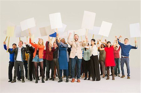 person holding sign - Diverse crowd with picket signs Stock Photo - Premium Royalty-Free, Code: 6113-07730652