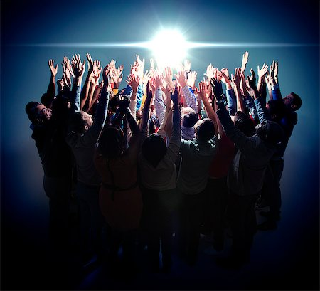 Diverse group reaching for bright light Stock Photo - Premium Royalty-Free, Code: 6113-07730654