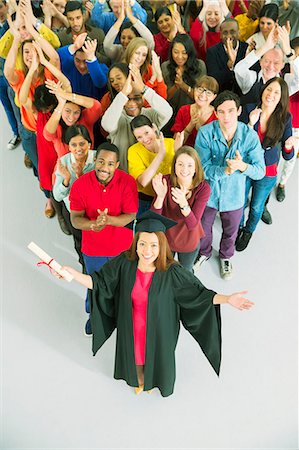 Clapping crowd behind graduate Stock Photo - Premium Royalty-Free, Code: 6113-07730659