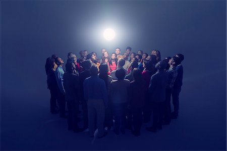 strategy - Diverse crowd around bright light Stock Photo - Premium Royalty-Free, Code: 6113-07730663