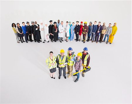 female police officer happy - Workforce behind construction workers Stock Photo - Premium Royalty-Free, Code: 6113-07730668
