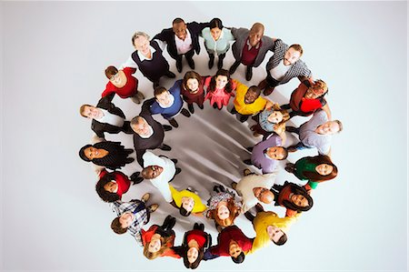 Portrait of confident business people in circle Stock Photo - Premium Royalty-Free, Code: 6113-07730680