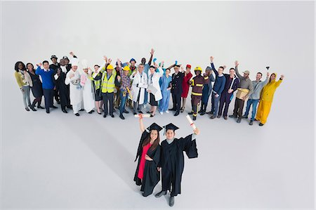 female police officer happy - Workforce cheering behind confident graduates Stock Photo - Premium Royalty-Free, Code: 6113-07730685