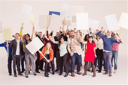 person holding sign - Protesters with picket signs Stock Photo - Premium Royalty-Free, Code: 6113-07730699