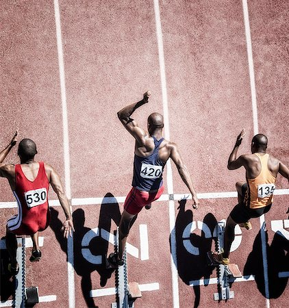 sprint - Sprinters taking off from starting block Stock Photo - Premium Royalty-Free, Code: 6113-07730605