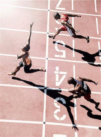 finish line - Runners crossing finish line Stock Photo - Premium Royalty-Free, Code: 6113-07730606