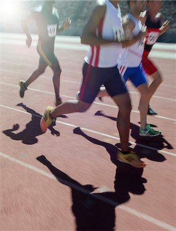 shadow - Runners racing on track Stock Photo - Premium Royalty-Free, Code: 6113-07730613