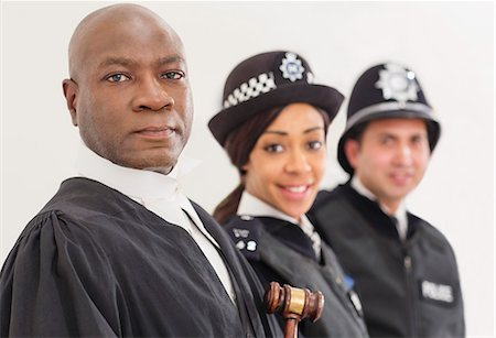 Portrait of confident judge and police Stock Photo - Premium Royalty-Free, Code: 6113-07730621