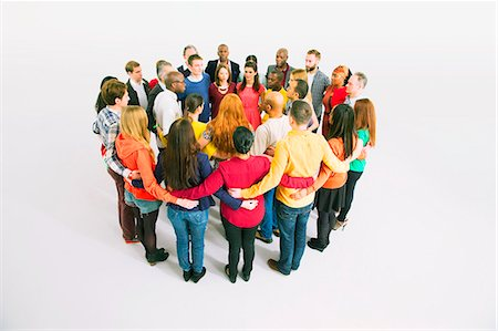 Diverse crowd in huddle Stock Photo - Premium Royalty-Free, Code: 6113-07730626