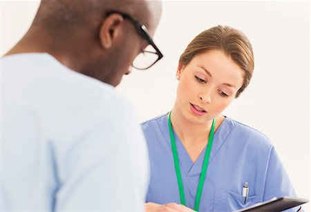 focus on background - Nurse talking with patient Stock Photo - Premium Royalty-Free, Code: 6113-07730628