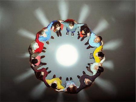 Diverse group around bright light Stock Photo - Premium Royalty-Free, Code: 6113-07730637