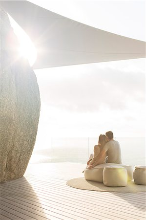 Couple relaxing together on modern balcony Stock Photo - Premium Royalty-Free, Code: 6113-07730773