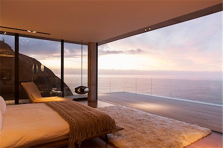 Modern bedroom overlooking ocean Stock Photo - Premium Royalty-Free, Code: 6113-07730788