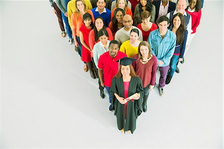 Diverse crowd behind confident graduate Stock Photo - Premium Royalty-Free, Code: 6113-07730725