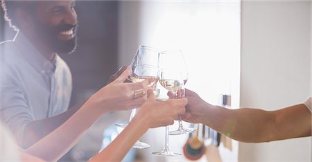 Friends toasting each other at party Stock Photo - Premium Royalty-Free, Code: 6113-07730843