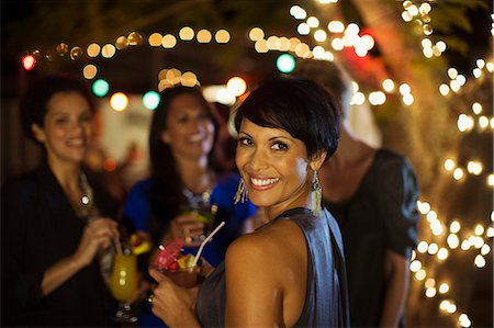 party - Woman smiling at party Stock Photo - Premium Royalty-Free, Code: 6113-07730860