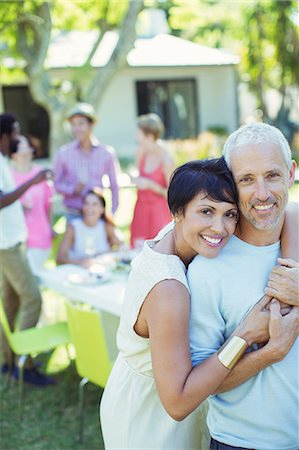 Couple hugging at party Stock Photo - Premium Royalty-Free, Code: 6113-07730867
