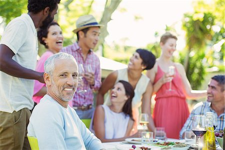 Man smiling at party outdoors Stock Photo - Premium Royalty-Free, Code: 6113-07730865
