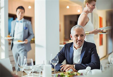 Man sitting at table at dinner party Stock Photo - Premium Royalty-Free, Code: 6113-07730875