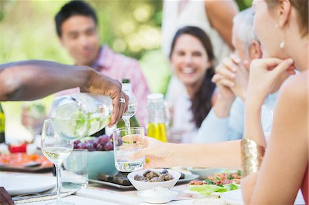 Friends eating together outdoors Stock Photo - Premium Royalty-Free, Code: 6113-07730878