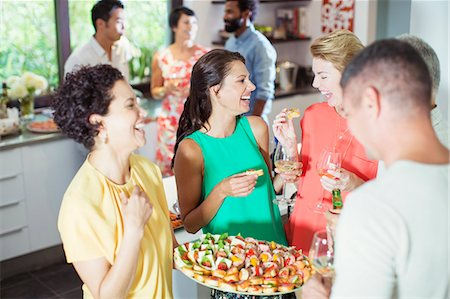 Woman serving friends at party Stock Photo - Premium Royalty-Free, Code: 6113-07730884