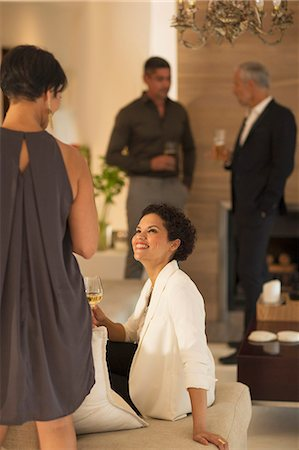 Women talking at party Stock Photo - Premium Royalty-Free, Code: 6113-07730885