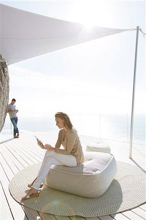 rich lifestyle - Woman using digital tablet on modern balcony Stock Photo - Premium Royalty-Free, Code: 6113-07730804