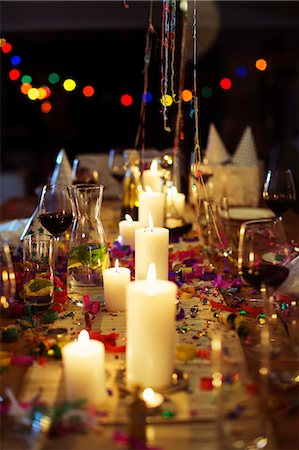 Lit candles on table at party Stock Photo - Premium Royalty-Free, Code: 6113-07730816