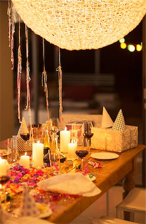 Candles and gifts on table at birthday party Stock Photo - Premium Royalty-Free, Code: 6113-07730823