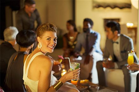 entertainment - Woman smiling at party Stock Photo - Premium Royalty-Free, Code: 6113-07730943