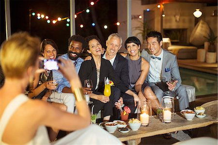 party - Woman taking picture of friends at party Stock Photo - Premium Royalty-Free, Code: 6113-07730944