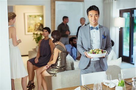 party - Man serving food at dinner party Stock Photo - Premium Royalty-Free, Code: 6113-07730966