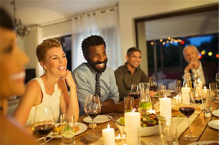 party - Friends laughing at dinner party Stock Photo - Premium Royalty-Free, Code: 6113-07730973