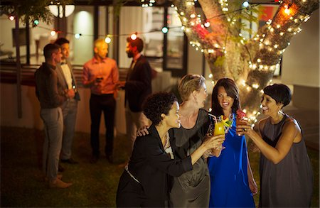 Friends toasting each other at party Stock Photo - Premium Royalty-Free, Code: 6113-07730997