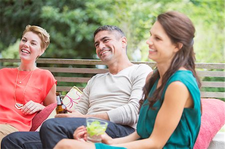 Friends relaxing together outdoors Stock Photo - Premium Royalty-Free, Code: 6113-07730996