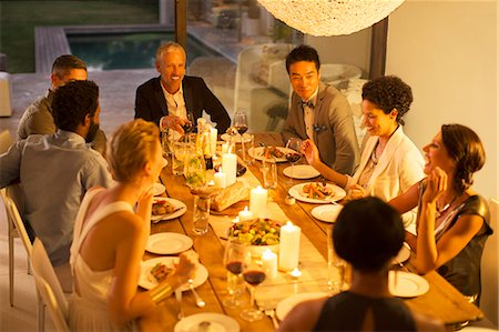 party - Friends eating together at dinner party Stock Photo - Premium Royalty-Free, Code: 6113-07730916