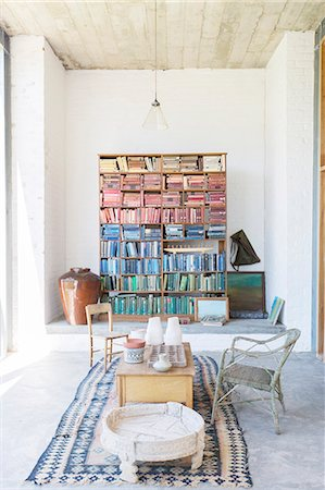Bookshelves and coffee table in rustic house Stock Photo - Premium Royalty-Free, Code: 6113-07731077