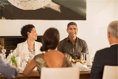 Friends laughing at dinner party Stock Photo - Premium Royalty-Free, Code: 6113-07731003