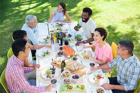 party - Friends talking at table outdoors Stock Photo - Premium Royalty-Free, Code: 6113-07731001