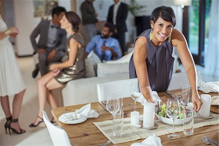 Woman serving food at dinner party Stock Photo - Premium Royalty-Free, Code: 6113-07731033