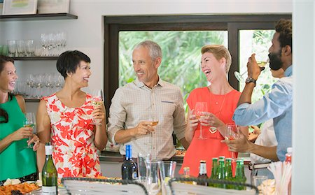 Friends laughing together at party Stock Photo - Premium Royalty-Free, Code: 6113-07731034
