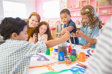school - Students painting in class Stock Photo - Premium Royalty-Free, Code: 6113-07731159
